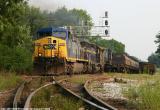 A SB coal train pounds the NS diamond at Princeton