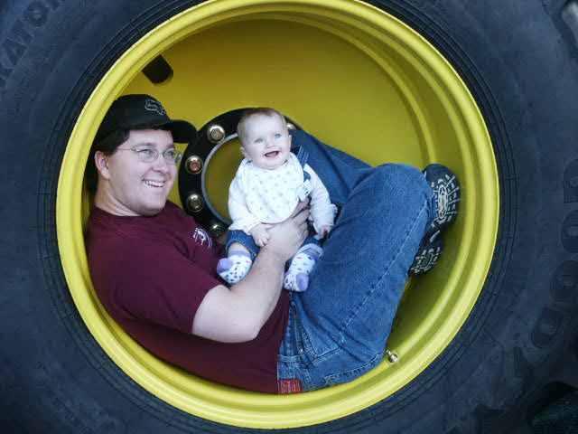 Bill  & Lilli in tractor wheel 1.jpg