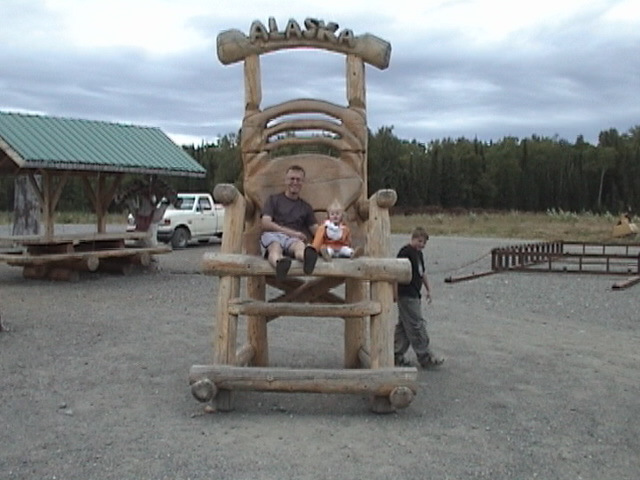 Lilli in the big chair with uncle Nick.JPG