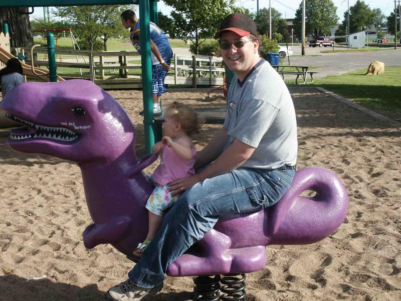 Riding the purple dinosour with daddy.jpg