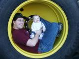Bill  & Lilli in tractor wheel 1.jpg