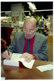 Allen Ginsberg signing his book