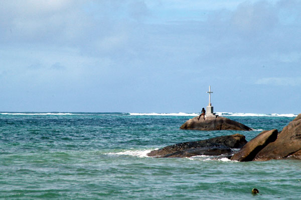 Cross erected on a rock offshore