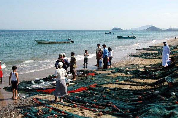 Spreading the nets along the beach