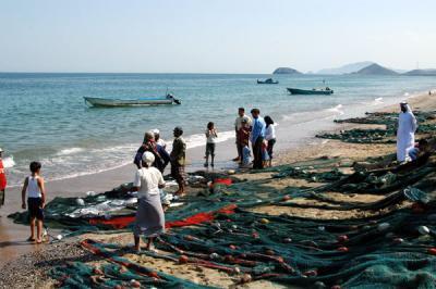Spreading the nets along the beach