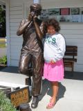 Sarah with harmonica player statue