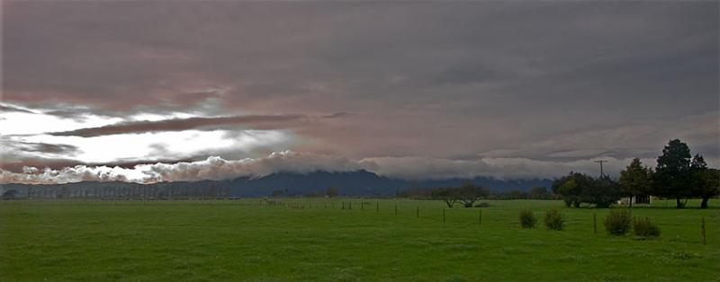 Green Pasture under Monochrome Sky by Gilles